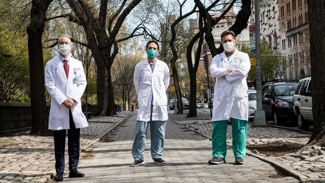 David Reich, MD and President and COO of The Mount Sinai Hospital, J Mocco, MD, Director of Mount Sinai's Cerebrovascular Center and Hooman Poor, MD, an ICU doctor pose together outside the hospital in Manhattan, during the outbreak of the coronavirus disease (COVID-19) in New York City. (Reuters)
