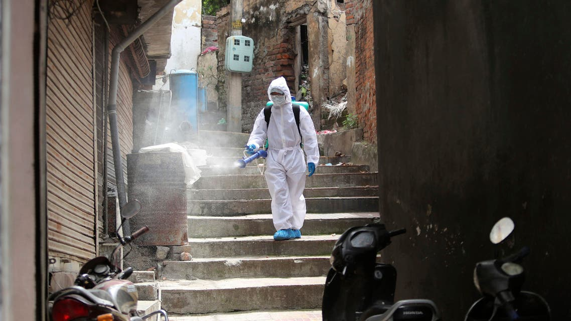 An Indian municipal worker disinfects an area during lockdown to prevent the spread of new coronavirus in Jammu, India on April 16, 2020. (AP)