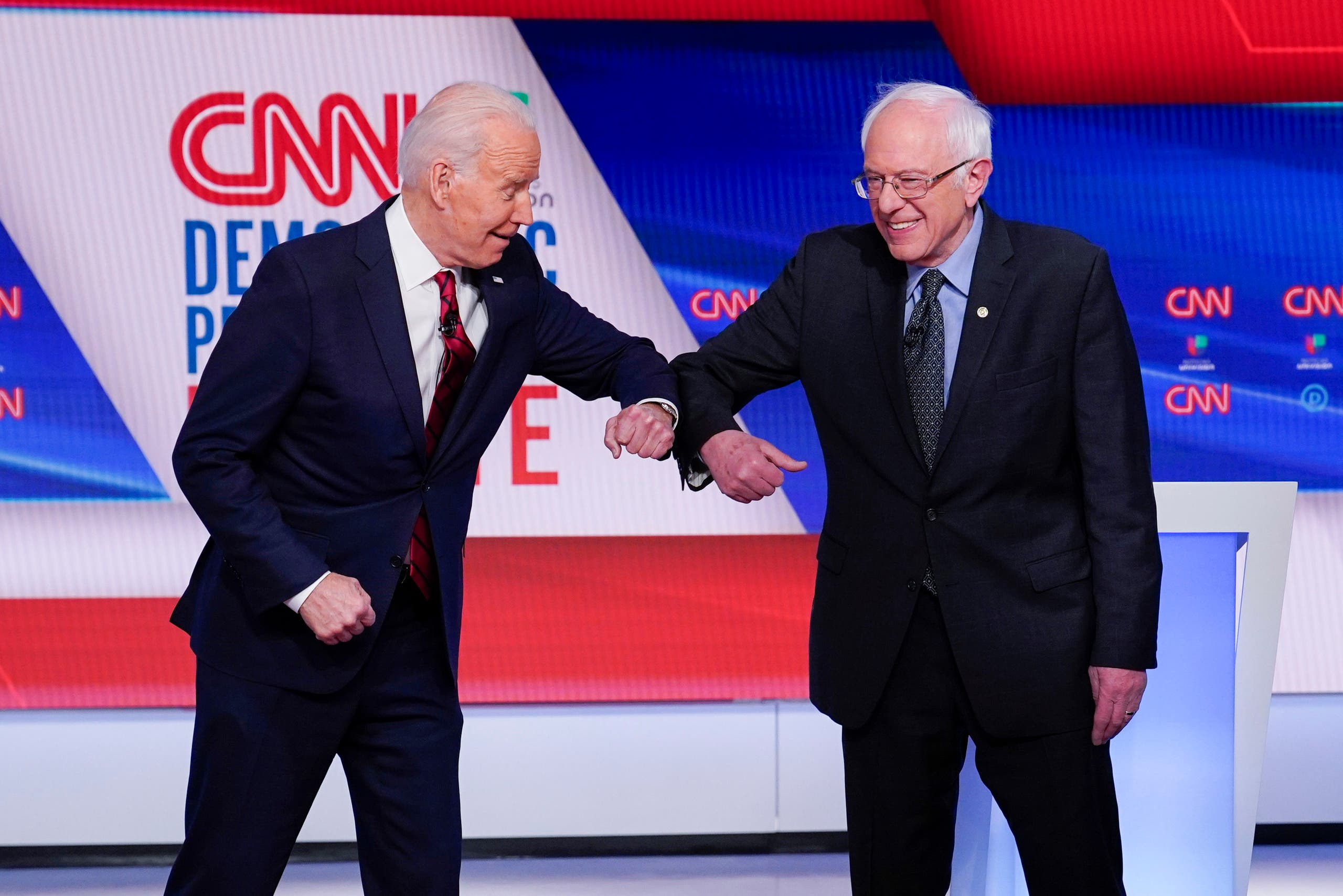 Joe Biden and Bernie Sanders greet one another before they participate in a Democratic presidential primary debate at CNN Studios in Washington on March 15, 2020. (File Photo: AP)