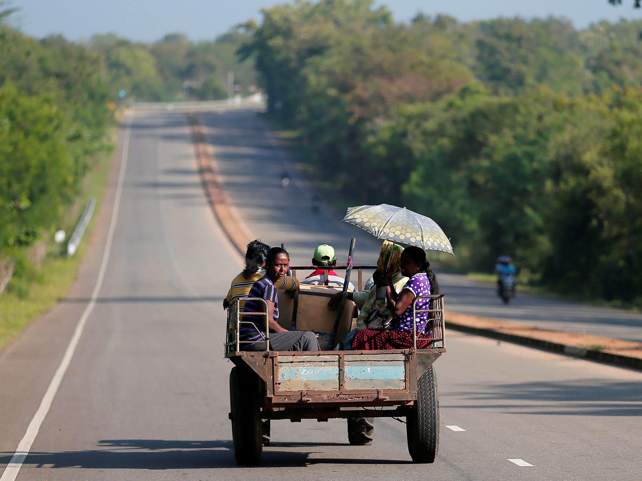 Villagers travel in a tractor on a newly built road in Hambantota, Sri Lanka March 24, 2019. (Reuters)
