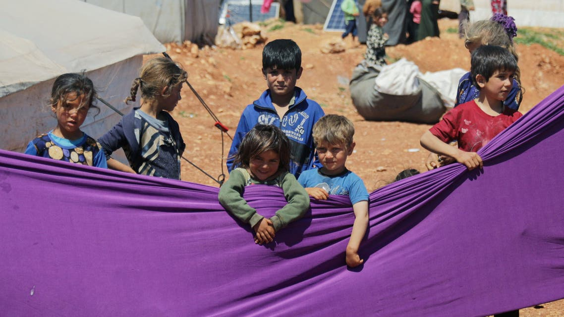 Displaced children take part in an event organzied by Violet Organization, in an effort to spread awareness and encourage safety amid coronavirus disease (COVID-19) fears, at a camp in the town of Maarat Masrin in northern Idlib, Syria April 14, 2020. Picture taken April 14, 2020. REUTERS/Khalil Ashawi