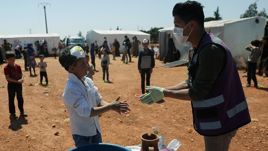 A displaced boy takes part in event organzied by Violet Organization, in an effort to spread awareness and encourage safety amid coronavirus disease (COVID-19) fears, at a camp in the town of Maarat Masrin in northern Idlib, Syria April 14, 2020. Picture taken April 14, 2020. REUTERS/Khalil Ashawi