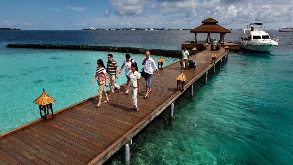 Foreign tourists arrive in a resort in the Kurumba island in Maldives on Feb. 12, 2012. (AP)