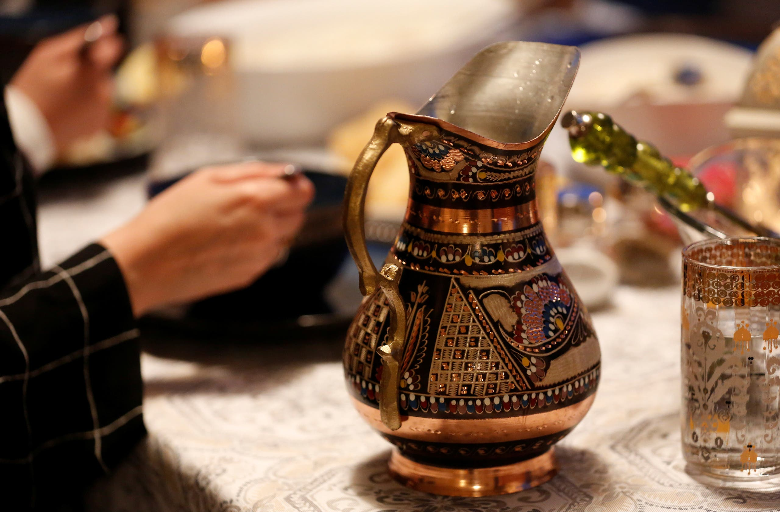 An intricate water vase sits on the table as a family eats their iftar meal on the first day of Ramadan in Bellevue. (File photo: Reuters)