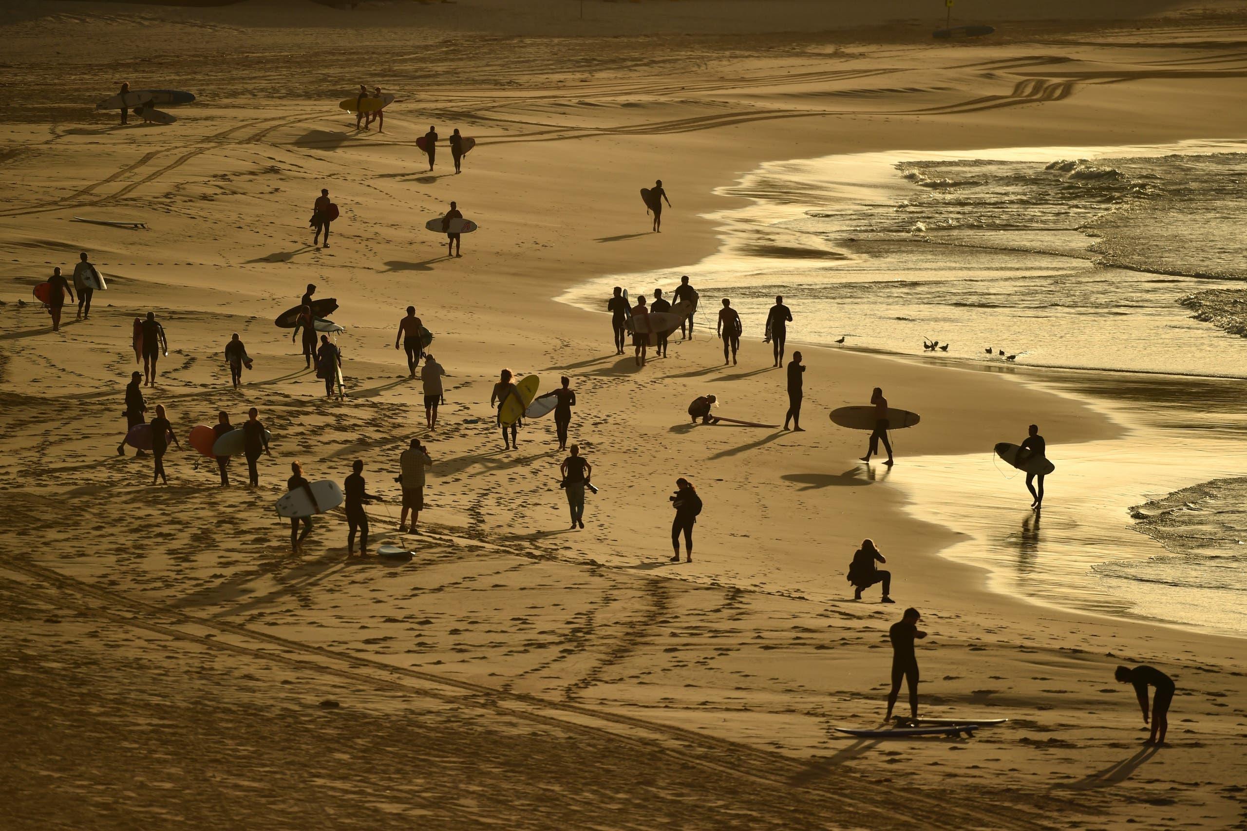 Surfers return to Bondi Beach. (AFP)