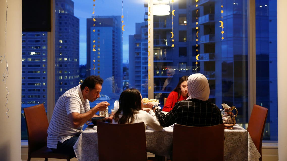 A family eats their iftar meal during the coronavirus disease (COVID-19) outbreak in Bellevue. (Reuters)