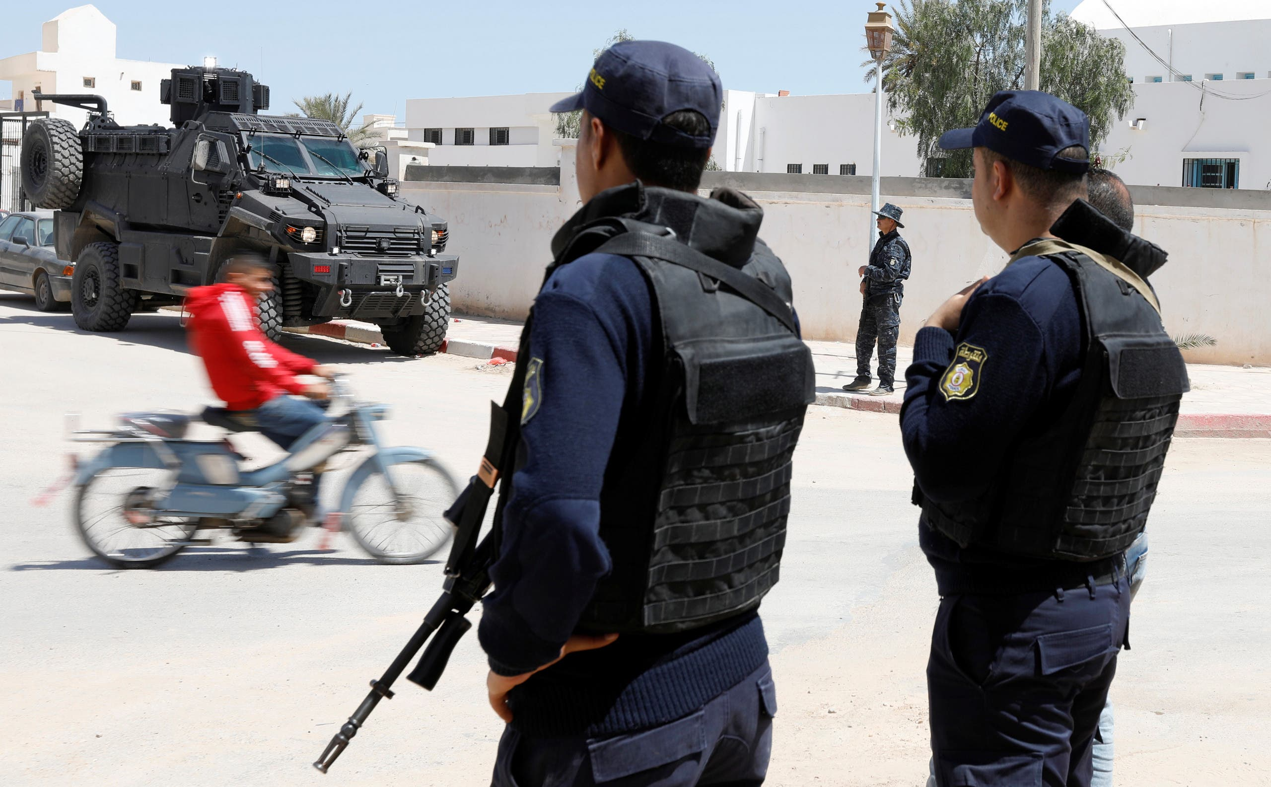 Police officers stand guard in the town of Ben Guerdane, near the Libyan border, in Tunisia on April 16, 2019.  (Reuters)