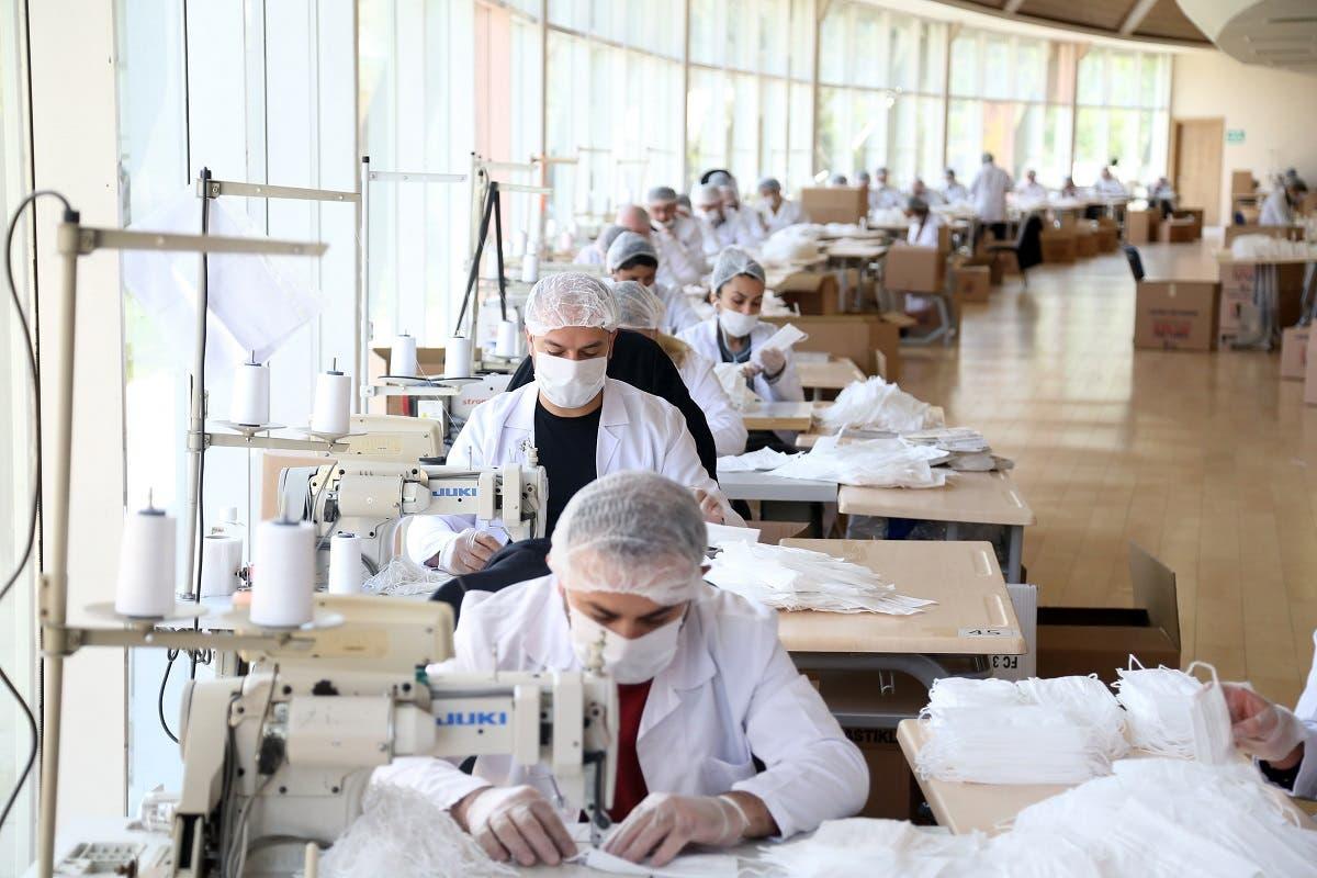 Employees of Ankara Metropolitan Municipality youth center sews face masks, in Ankara, Turkey, on April 28, 2020, amid the spread of the novel coronavirus. (AFP)