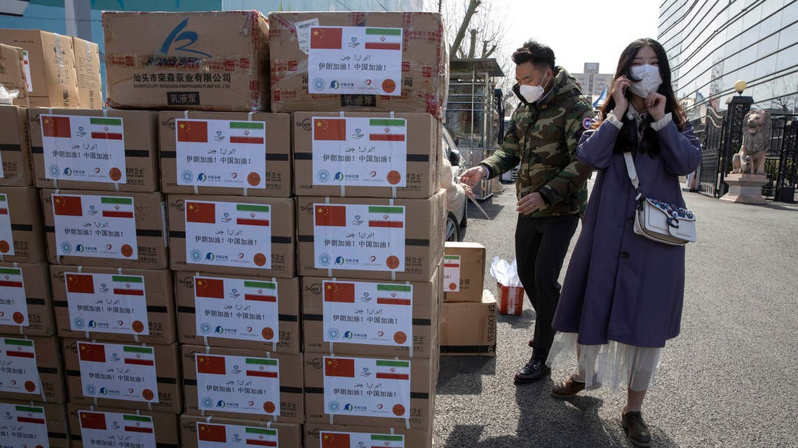 Workers from a charity foundation prepare boxes of disinfectant tablets to be donated to Iran in Beijing on Monday, March 16, 2020. (AP)