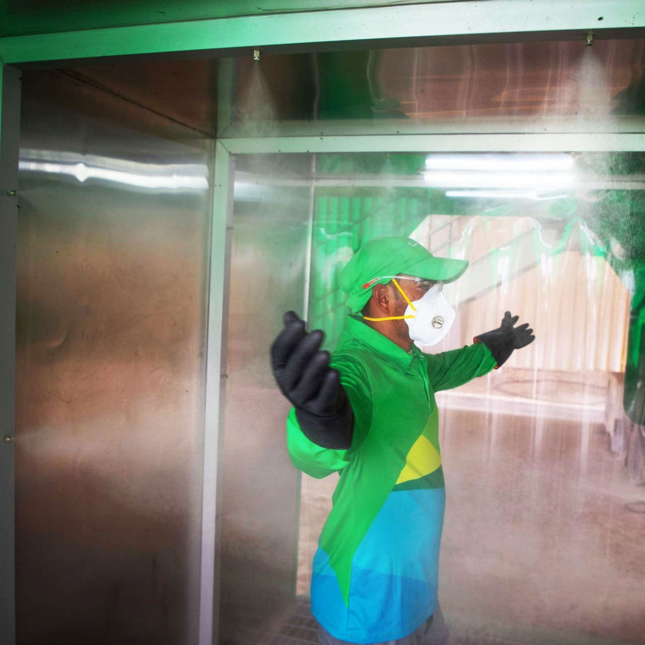 A Bee'ah employee trials a disinfection pod, April 27, 2020. (WAM)