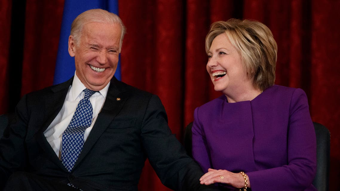 Then-Vice President Joe Biden, left, laughs with former Secretary of State Hillary Clinton on Capitol Hill on Dec. 8, 2016, in Washington. (AP)