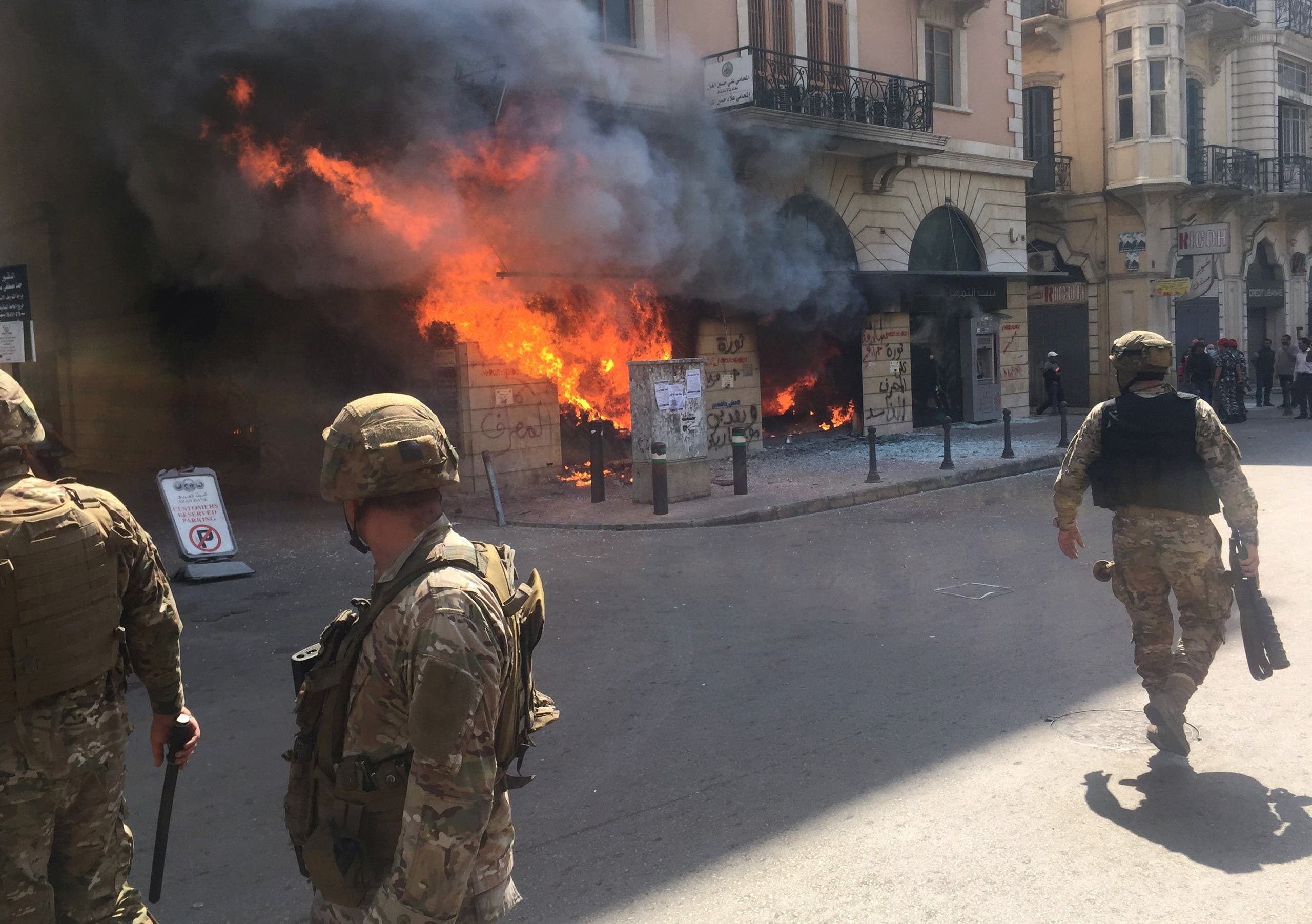 Lebanese soldiers are seen near a bank on fire during unrest, as an economic crisis brings demonstrations back onto the streets in Tripoli, Lebanon April 28, 2020. (File photo: Reuters)