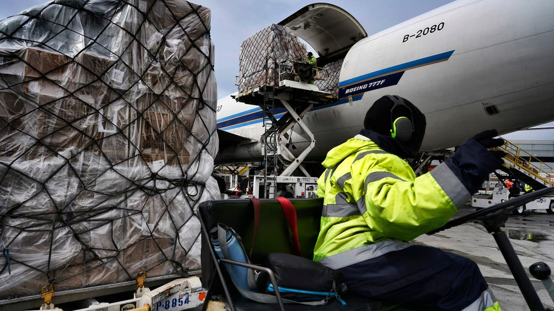 Ground crew at the Los Angeles International airport unload pallets of supplies of medical personal protective equipment, PPE, from a China Southern Cargo plane upon arrival on Friday, April 10, 2020.