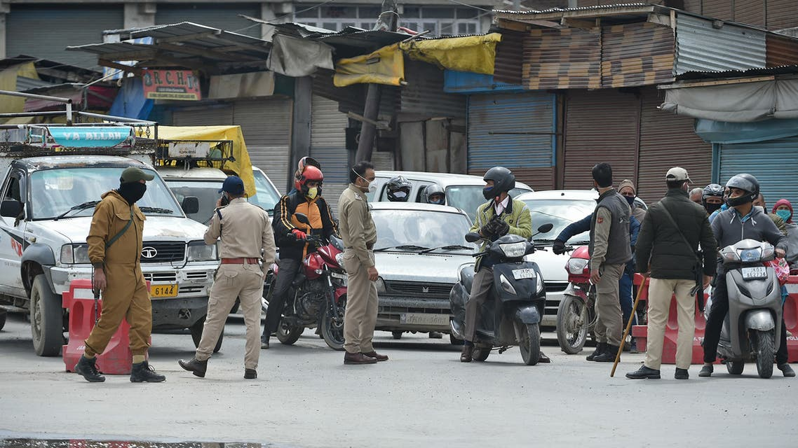 Indian police stops vehicles at a checkpoint during a government-imposed nationwide lockdown as a preventive measure against the COVID-19 coronavirus, in Srinagar on April 20, 2020.