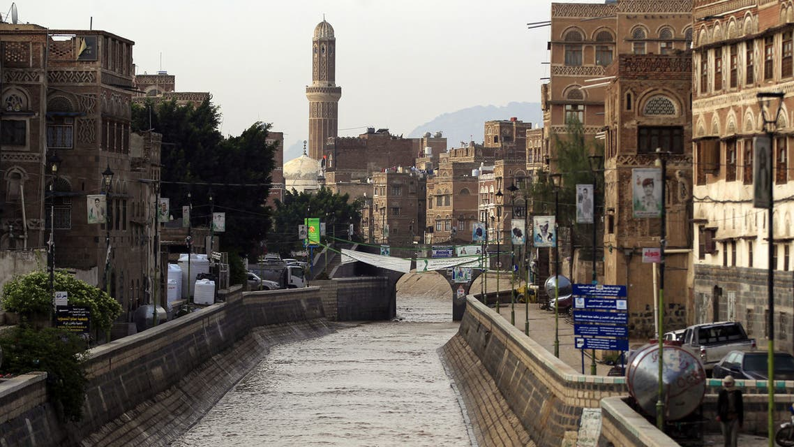 Flood water fills a canal following heavy rains in the Old City of Yemen's capital Sanaa on April 14, 2020. (AFP)