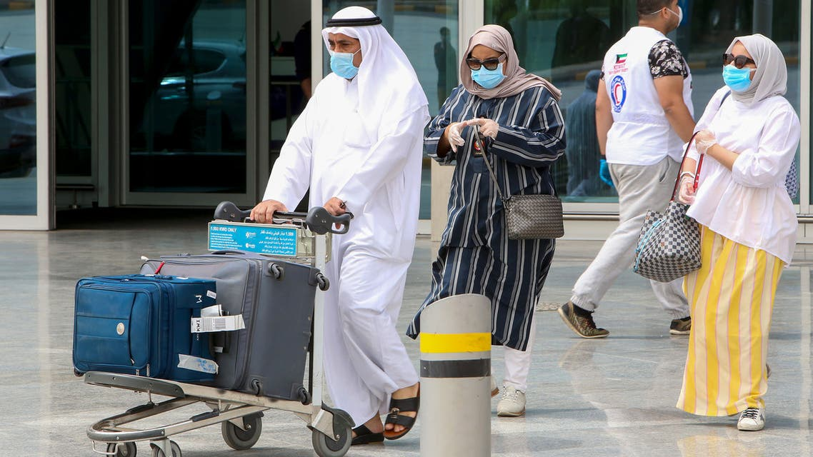 A Kuwaiti national, residing abroad, leaves the Kuwait International airport in the capital upon her return as part of a repatriation plan on April 19, 2020, and ahead of being taken to mandatory home quarantine.