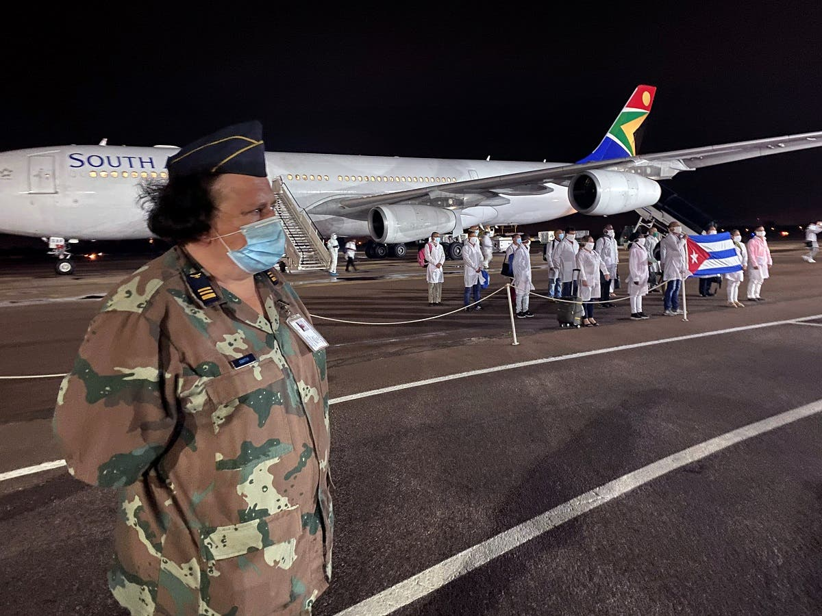 A member of the South African military stands guard as a group of Cuban doctors arrive to combat the spread of the coronavirus disease (COVID-19), in Pretoria, South Africa. (Reuters)