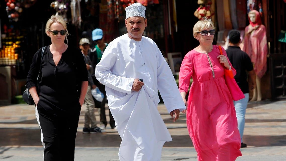 People walk on a street on March 18, 2015 in the Omani capital, Muscat. (AFP)