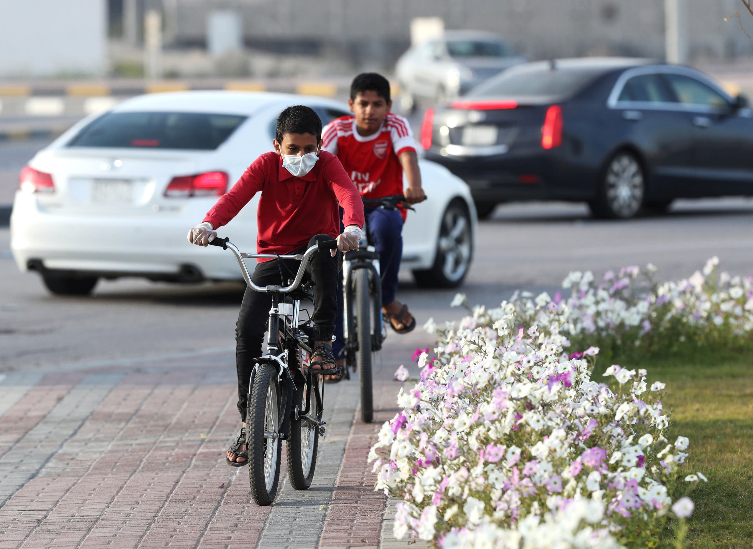 A boy wears a protective face mask, as he rides a bicycle, after Saudi Arabia imposed a temporary lockdown on the province of Qatif, following the spread of coronavirus, in Qatif, Saudi Arabia. (File photo: Reuters)