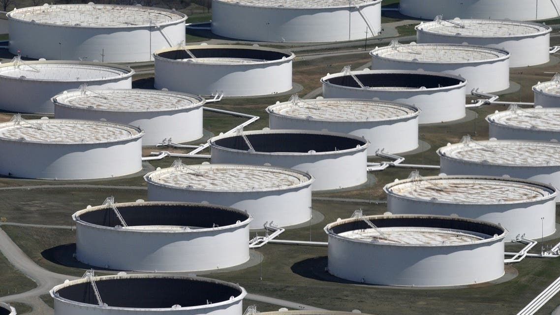 Crude oil storage tanks are seen from above at the Cushing oil hub, appearing to run out of space to contain a historic supply glut that has hammered prices, in Cushing, Oklahoma. (Reuters)
