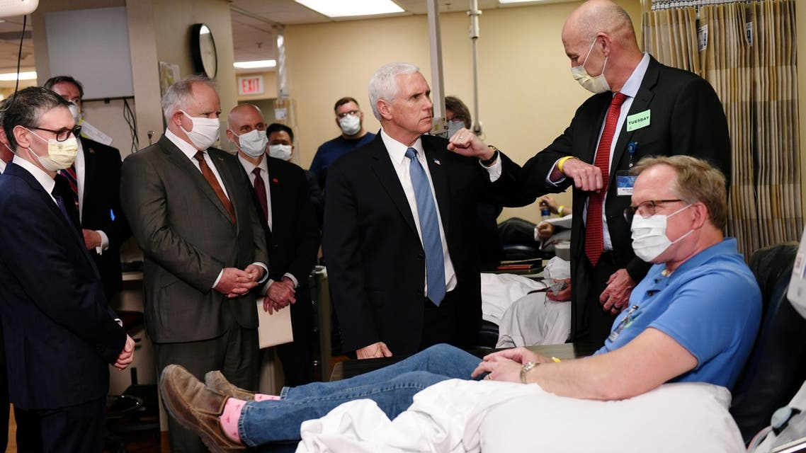 Vice President Mike Pence visits Dennis Nelson, a recovered COVID-19 disease patient who is now donating his blood for research on the virus and disease as Pence tours Mayo Clinic facilities supporting the coronavirus disease (COVID-19) research and treatment in Rochester, Minnesota, U.S., April 28, 2020. REUTERS/Nicholas Pfosi REFILE - ADDING INFORMATION