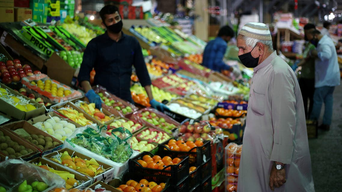 A Bahraini man wears a protective face mask following the outbreak of the coronavirus disease (COVID-19), as he shops at a vegetables market ahead of the holy month of Ramadan in Manama, Bahrain, April 23, 2020. REUTERS/Hamad I Mohammed