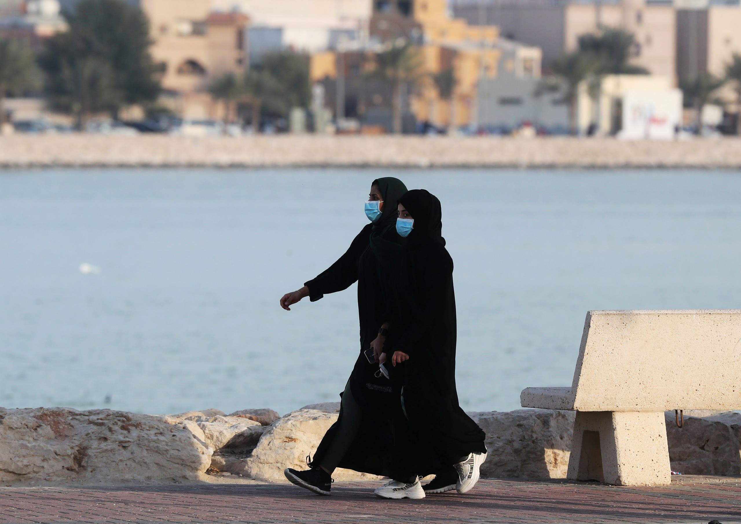 Women wear protective face masks, as they walk, after Saudi Arabia imposed a temporary lockdown on the province of Qatif, following the spread of coronavirus, in Qatif, Saudi Arabia March 10, 2020. (File photo; Reuters)