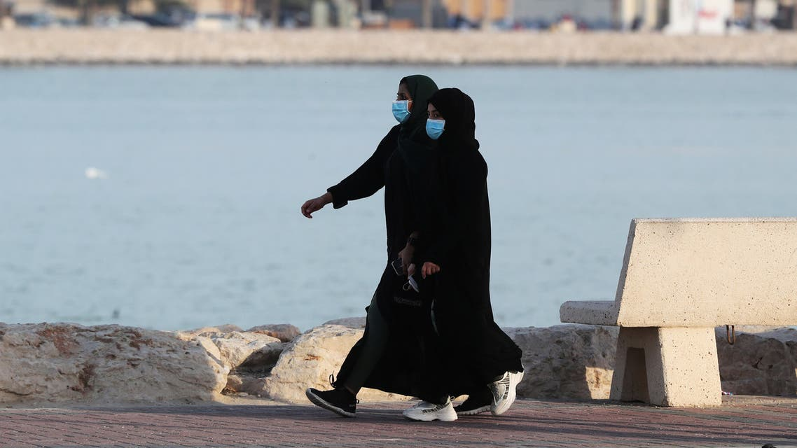 Women wear protective face masks, as they walk, after Saudi Arabia imposed a temporary lockdown on the province of Qatif, following the spread of coronavirus, in Qatif, Saudi Arabia March 10, 2020. REUTERS/Stringer