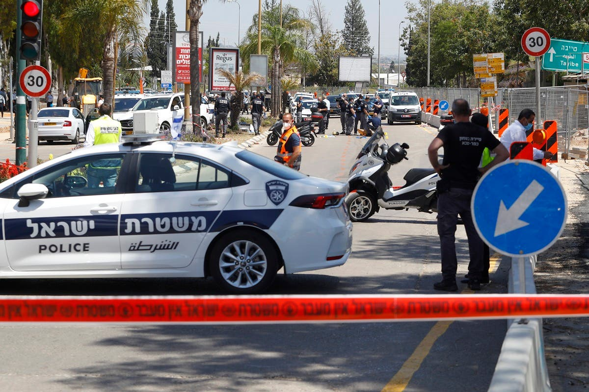 Israeli police secure the scene of a reported stabbing attack in the central Israeli city of Kfar Saba, northeast of Tel Aviv, on April 28, 2020. (AFP)
