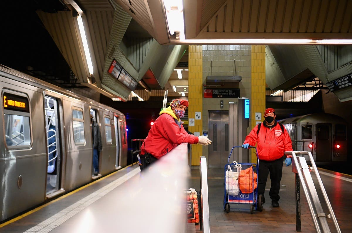 Jose Gonzalez and Jose Niejiaz of Guardian Angels deliver food and essentials to people in need in the subway on April 29, 2020 in New York City. (AFP)
