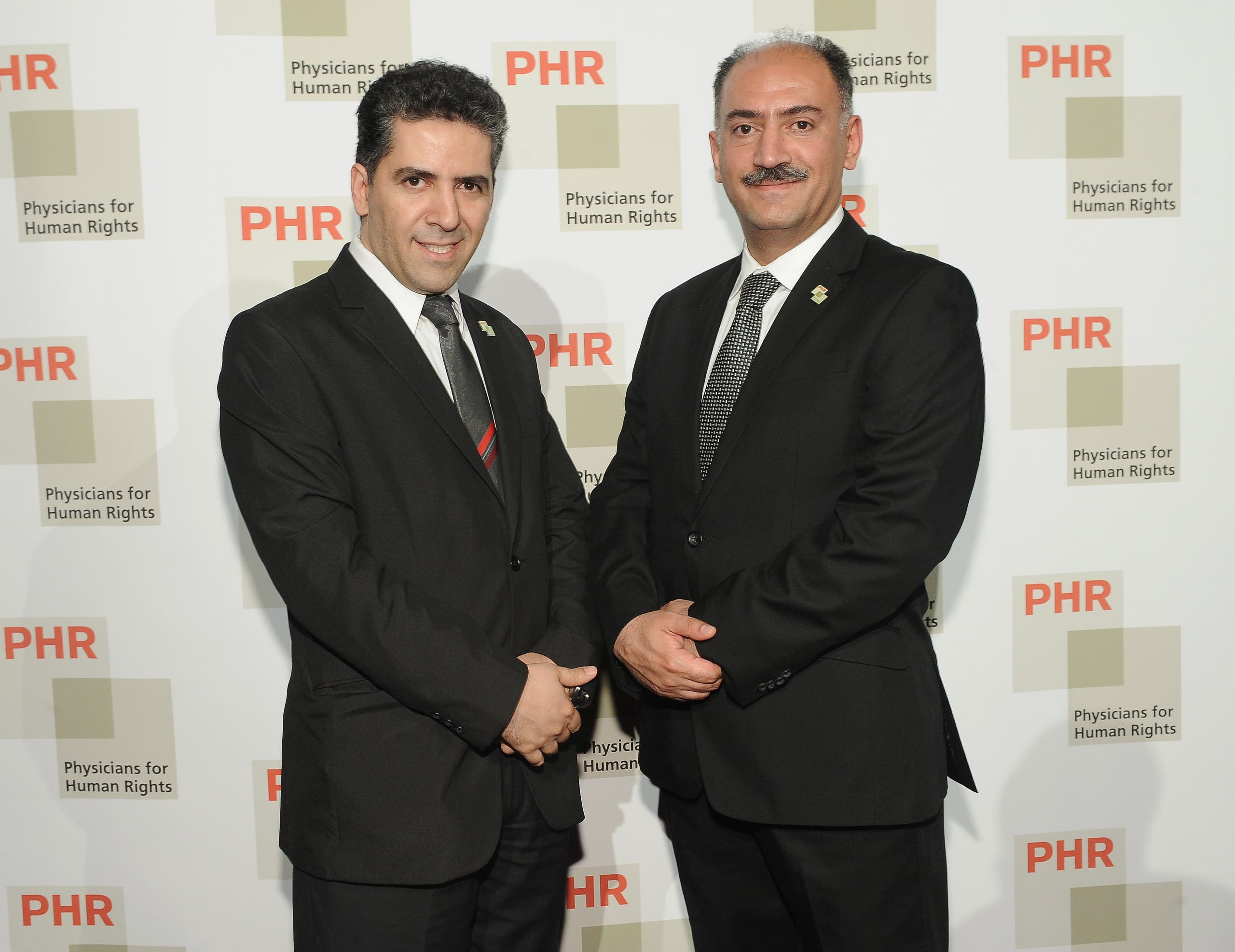 Renowned HIV doctors praised for their work by the World Health Organization Kamiar and Arash Alaei attend 2015 Physicians For Human Rights Gala on April 28, 2015 in New York City. (AP)