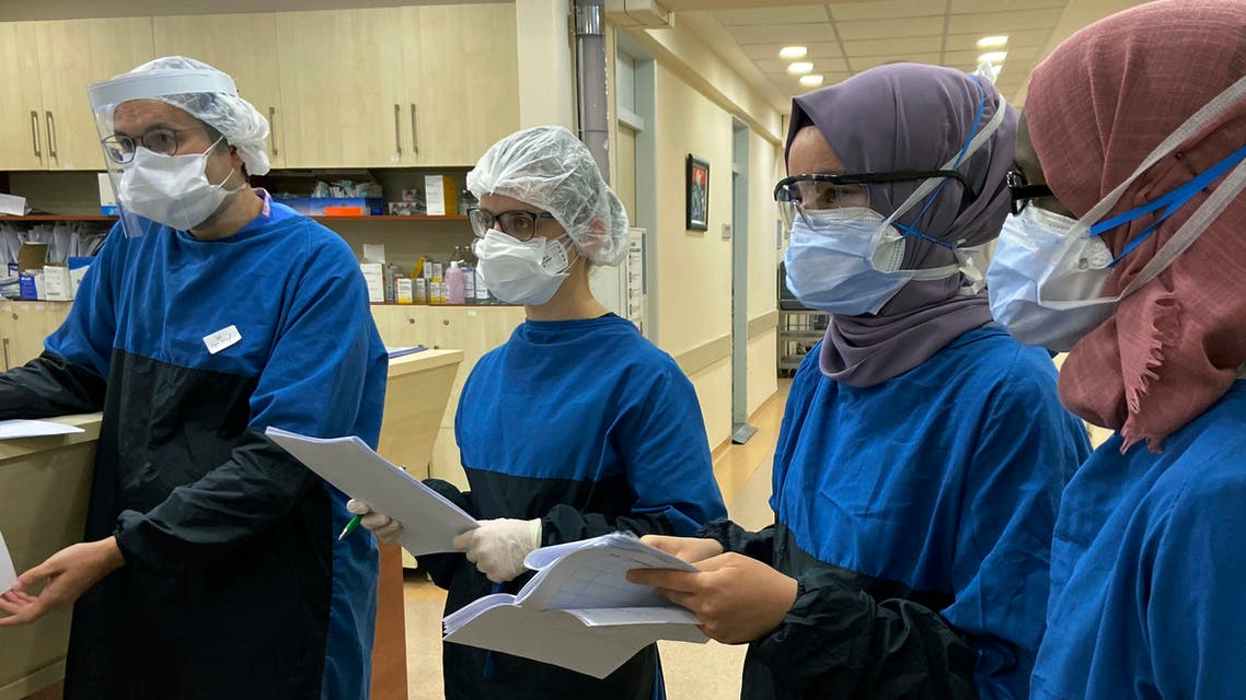 Medical personnel participate in a briefing at Istanbul University Cerrahpasa Hospital's ward dedicated to patients with coronavirus in Istanbul on April 28, 2020. (AP)