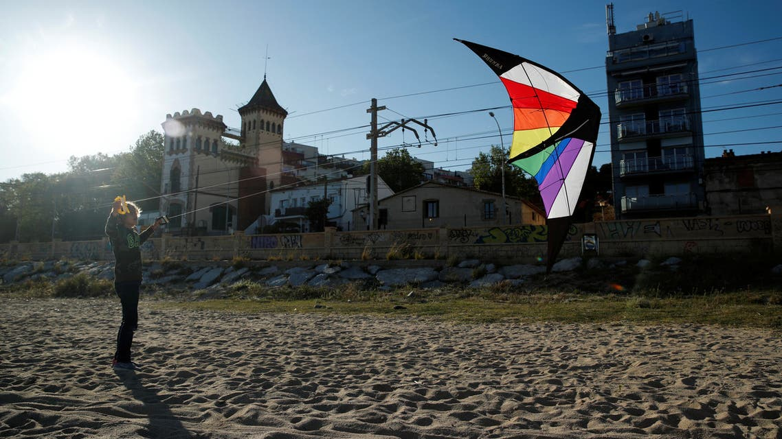 A boy flies a kite on a beach, after restrictions were partially lifted for children, following the coronavirus disease (COVID-19) outbreak in El Masnou, north to Barcelona, Spain, April 29, 2020. (Reuters)