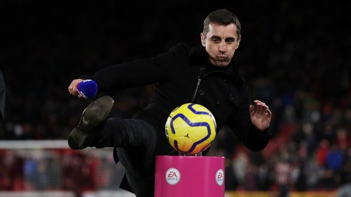 Gary Neville kicks the match ball off a plinth before a match. (Action Images via Reuters)
