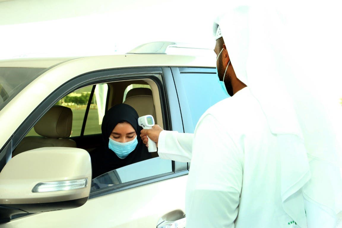 A woman being tested for coronavirus in the UAE, April 30, 2020. (WAM)
