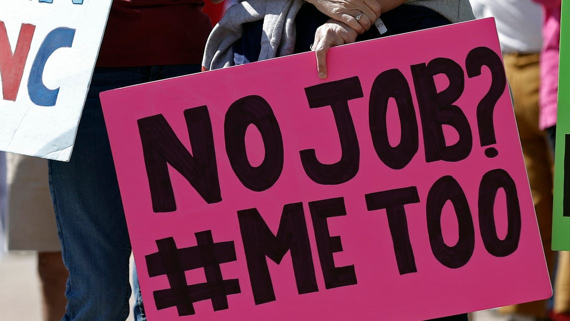In this photo taken Tuesday, April 28, 2020 in Raleigh, N.C. a woman holds a no job sign during a rally near the General Assembly. (AP)