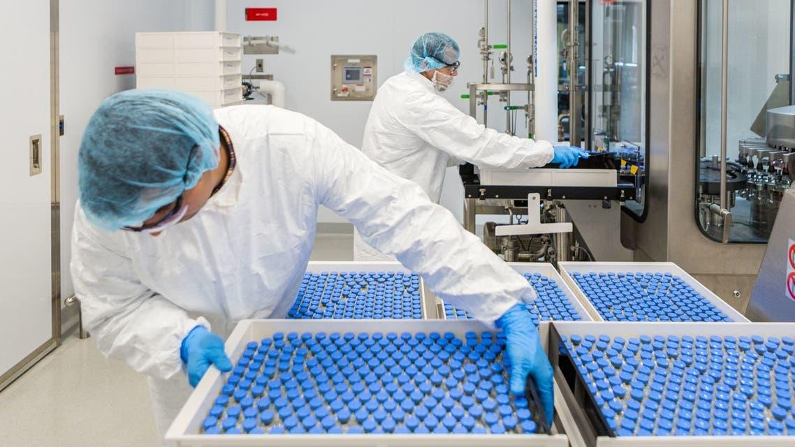 علاج كورونا - تصنيع أدوية (فرانس برس)