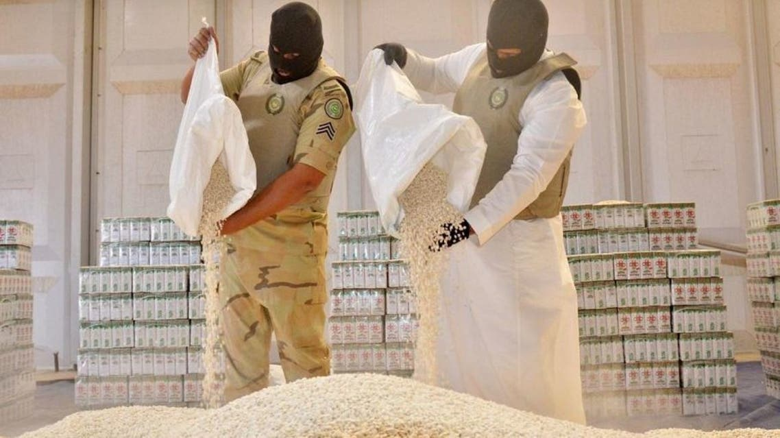 Members of the General Directorate of Narcotics Control display amphetamine pills seized after foiling an attempt to smuggle more than 19 million amphetamine pills into Saudi Arabia. (SPA)