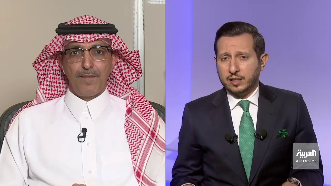 Saudi Arabia's Finance Minister Mohammed al-Jadaan (L) being interviewed by Al Arabiya's senior business presenter Naser ElTibi (R).