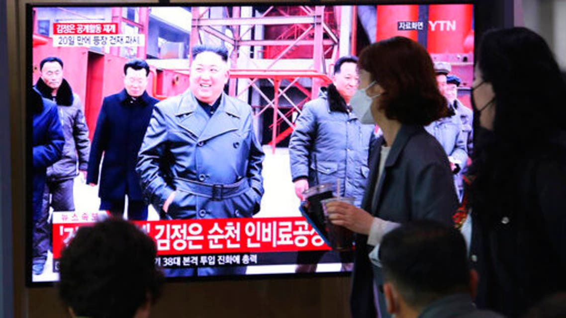 People watch a TV showing a file image of North Korean leader Kim Jong Un during a news program at the Seoul Railway Station in Seoul, South Korea, Saturday, May 2, 2020. (The Associated Press)