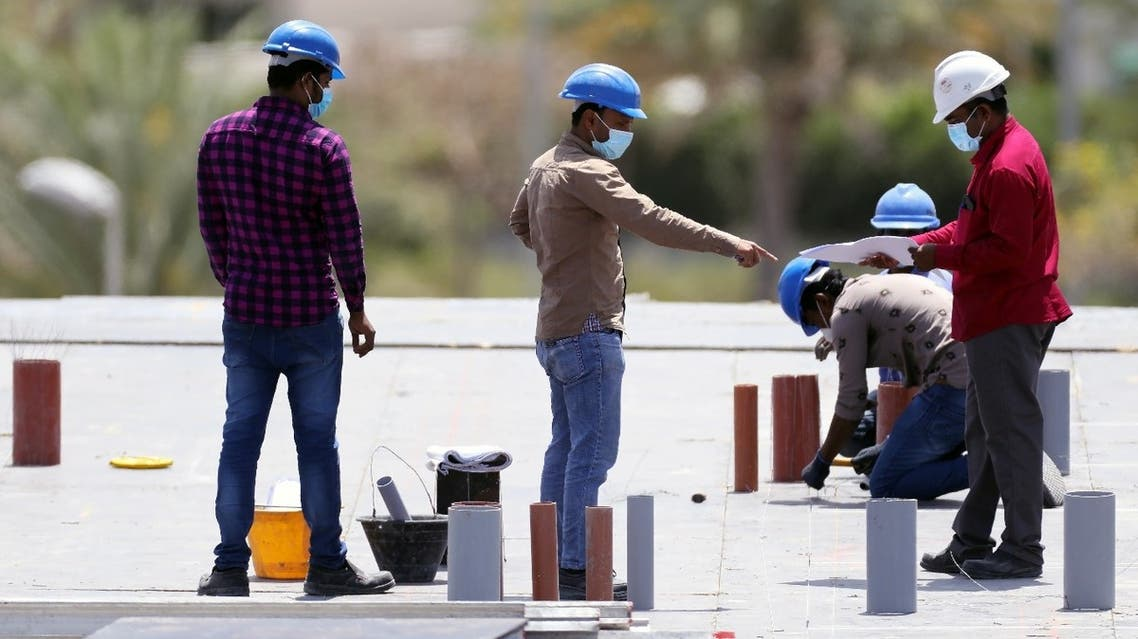 Workers wearing protective face masks work on a residential construction site, following the outbreak of coronavirus disease (COVID-19), in Dubai, United Arab Emirates, April 14, 2020. (Reuters)