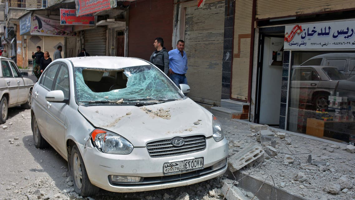 Damages on a street after explosions rocked Syria's central city of Homs on May 1, 2020. (AFP)