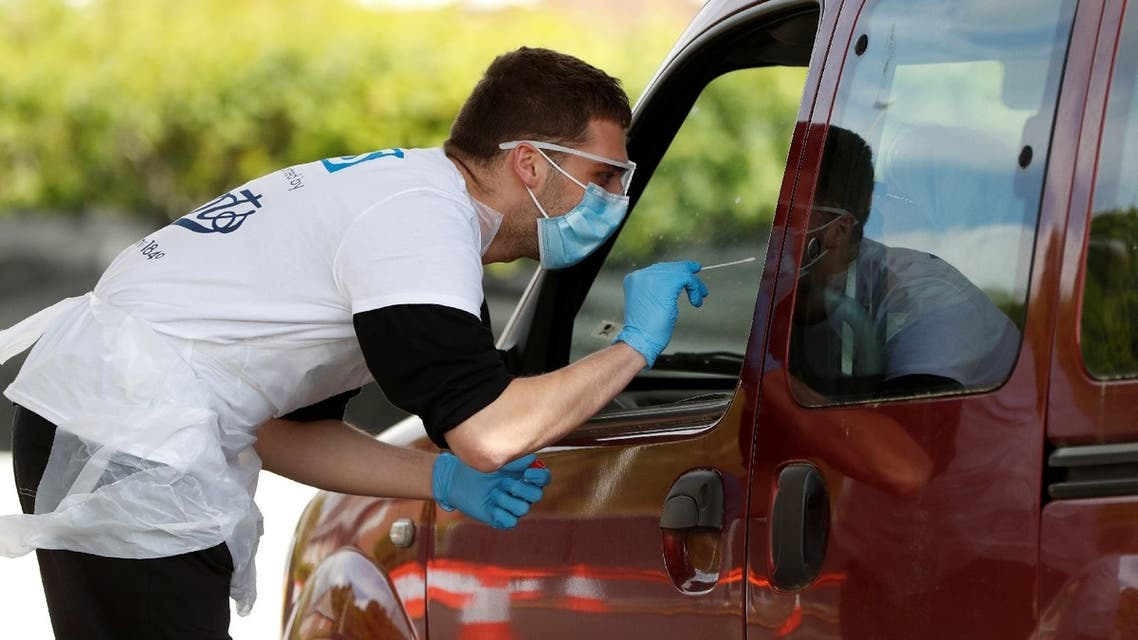 A volunteer from Boots chemist conducts a test at a coronavirus test site in Poole, following the outbreak of the coronavirus disease (COVID-19), Poole, Britain, May 2, 2020. (Reuters)