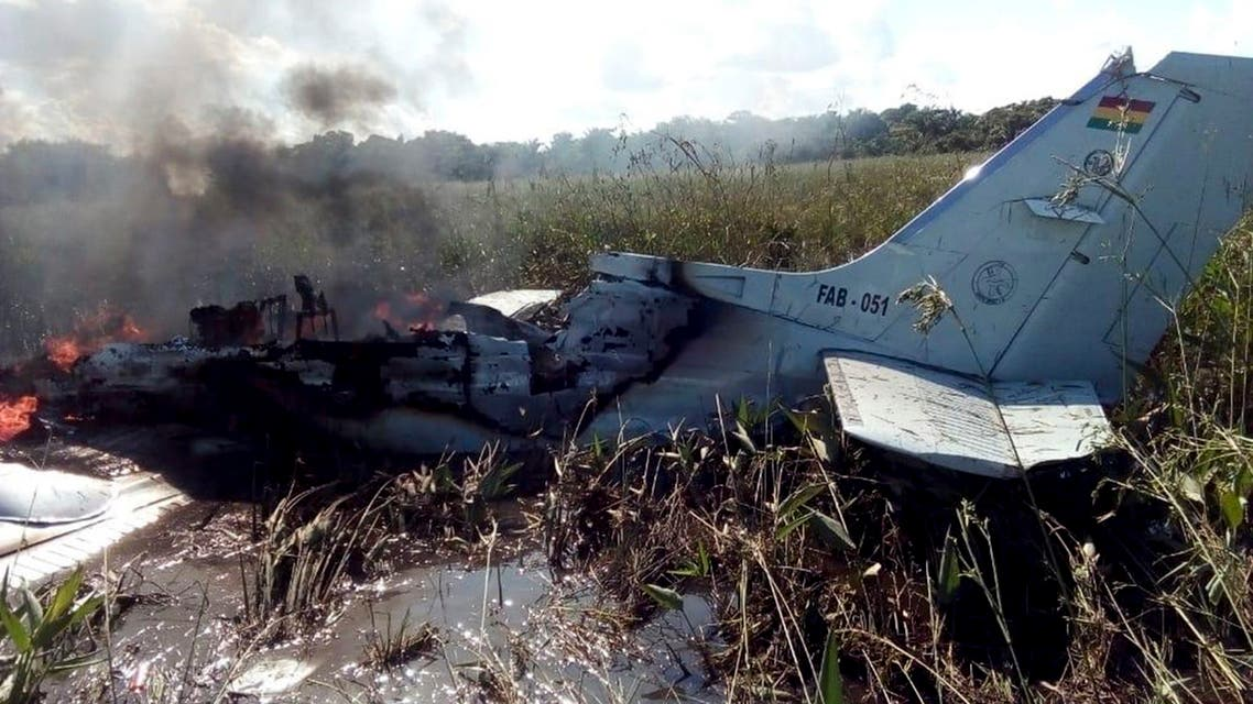 The remains of an aircraft from the Bolivian Air Force burn after crashing near Trinidad, Bolivia, Saturday, May 2, 2020. The plane, flying a humanitarian mission, crashed minutes after takeoff in the Amazonian region, killing all six occupants, including four Spaniards who were being ferried to catch a flight to their homeland, the Defense Ministry said Saturday. (AP Photo/Kevin Bustamante)