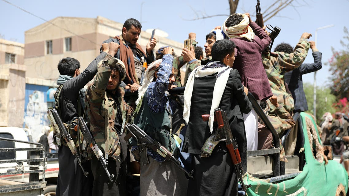 Armed Houthi followers ride on the back of a truck outside a hospital in Sanaa, Yemen April 8, 2020. Picture taken April 8, 2020. REUTERS/Khaled Abdullah