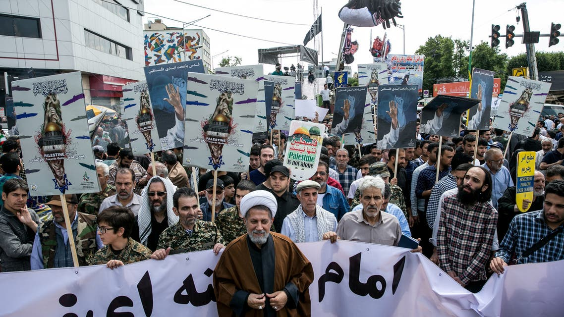 Iranians take part in a protest marking the annual al-Quds Day (Jerusalem Day) on the last Friday of the holy month of Ramadan in Tehran. (Reuters)