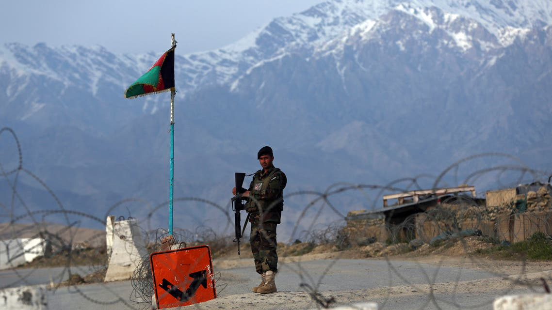 An Afghan National Army soldier stands guard at a checkpoint near the Bagram base north of Kabul, Afghanistan, on Wednesday, April 8, 2020. (AP)