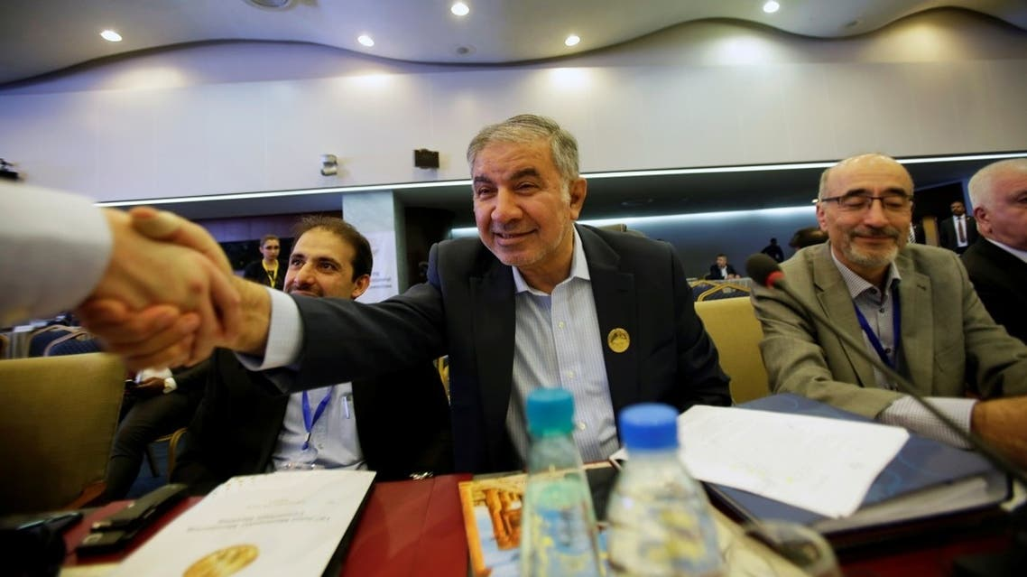 Iran's OPEC governor Hossein Kazempour Ardebili is greeted at the OPEC Ministerial Monitoring Committee in Algiers. (File photo: Reuters)