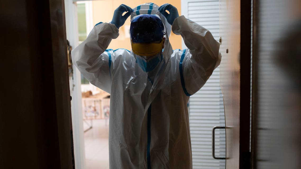 A medic from the CAP Manso primary care center leaves after visiting a coronavirus patient at his home in Barcelona on May 1, 2020. (Josep Lago/AFP)