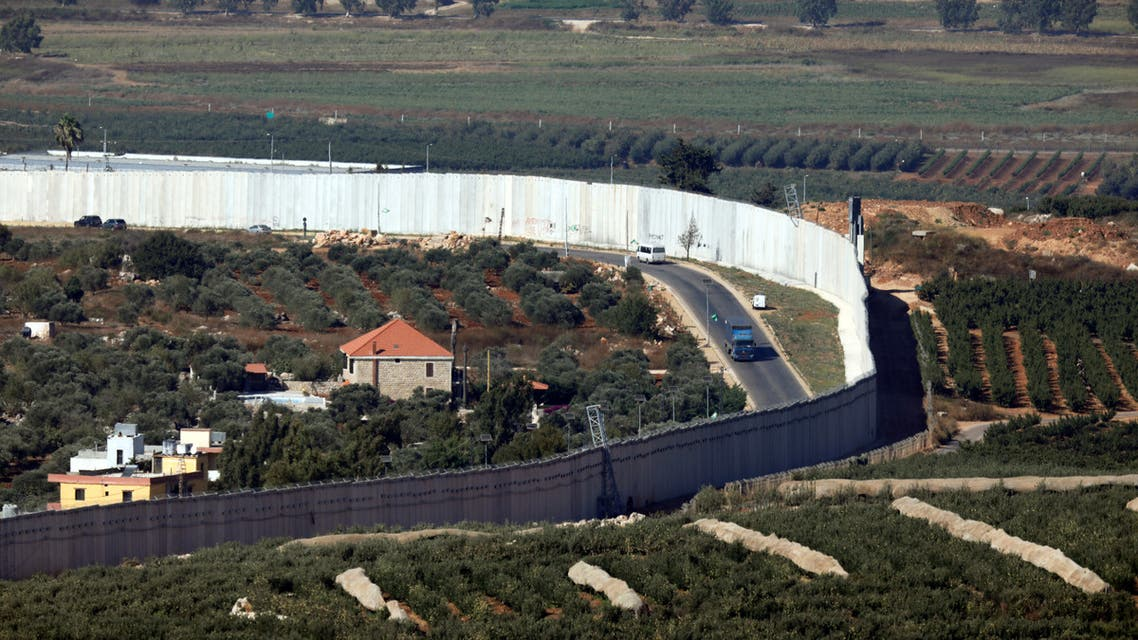 Houses and cars are seen in the Lebanese village of Adaisseh next to the Israel-Lebanon border, as seen from Kibbutz Misgav Am in northern Israel August 26, 2019. REUTERS/Amir Cohen